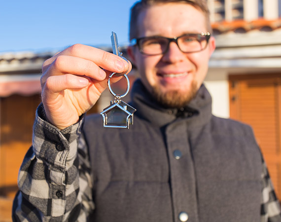 Man with key to house